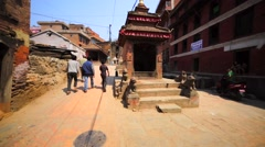 Street temple in Nepal city Bhaktapur that stayed undamaged after the earthquake Stock Footage