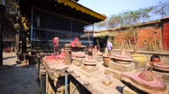 Temple with Lingams, abstract representation of Shiva. Bhaktopur, Nepal Stock Footage