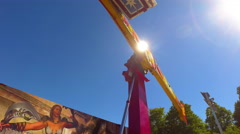 Fall Fair Static medium shot of long ride lifting people up into the air Stock Footage