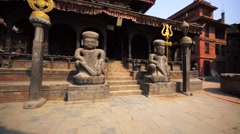 Entrace with two statues in front of the temple at Durbar square. Bhaktapur Stock Footage