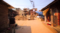 Man works at place where house used to be before earthquake in 2015. Bhaktapur Stock Footage