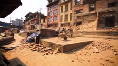 Men clean the street after the earthquake in 2015. Bhaktapur, Nepal Stock Footage