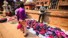 Flip-flops seller at street market. Bhaktapur, Nepal Stock Footage