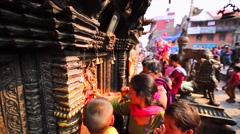 People pray near shrine at street. Bhaktapur, Nepal Stock Footage