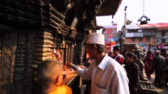 People pray near shrine at street. Big crowd and men playing cymbals. Bhaktapur Stock Footage