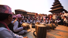 Men in national costumes play drums at square during Bisket Jatra celebration Stock Footage