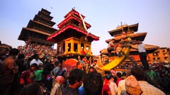 Men tie deity to big deity waggon. Bhaktapur, Nepal. People wait for spectacle Stock Footage