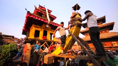 Two men tie the deity to the big deity waggon. Bhaktapur, Nepal Stock Footage