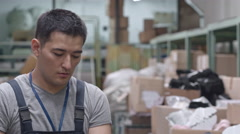 Warehouse Worker with Factory Trolley Stock Footage