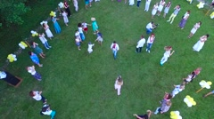 Rise above the crowd of people on the merry fun-filled family event in nature Stock Footage