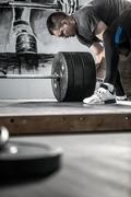 Preparation of barbell in gym Stock Photos