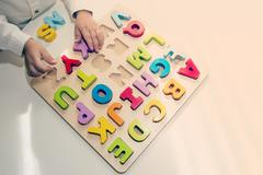 Table with learning letters game Stock Photos