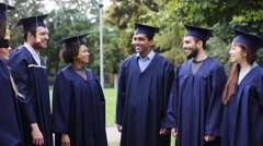 Happy students throwing mortar boards up Stock Footage