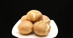 Cooked potatoes on a dish in turn table Stock Footage
