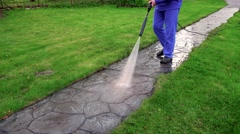 Long stone cobbled path and worker wash it Stock Footage