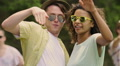 Cheerful male and female friends waving hands, dancing in sunglasses, slow-mo HD Footage