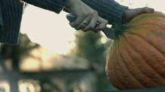 Pumpkin cutting and splitting Stock Footage