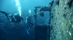Divers visiting the wreck Giannis D, Red Sea, Sharm el Sheikh, Egypt Stock Footage
