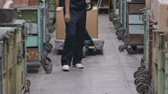 Female Warehouse Worker with Trolley Stock Footage