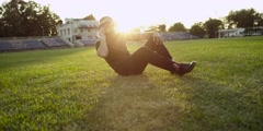 Business man with short hair and glasses falling down on the grass. Stock Footage