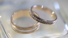 Wedding rings. Wedding rings lie on a transparent stone Stock Footage