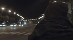 Young woman waiting taxi night city street hyperlapse cold tone shot Stock Footage