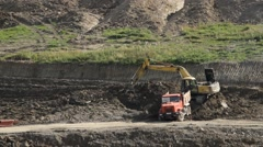 Truck and excavator working in quarry Stock Footage