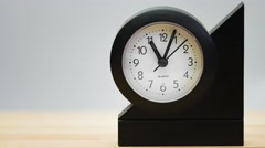Time lapse of a small clock on a wooden table. Stock Footage
