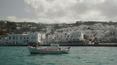 Pan of a fishing boat in chora on mykonos, greece Stock Footage