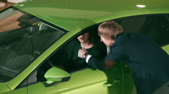 Seller trying explain to girl car specifications Stock Footage