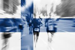 Marathon runner motion blur with blending  Finland flag Stock Photos