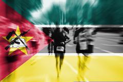 Marathon runner motion blur with blending  Mozambique flag Stock Photos