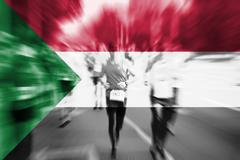 Marathon runner motion blur with blending  Sudan flag Stock Photos