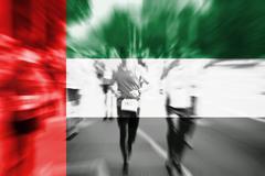 Marathon runner motion blur with blending  United Arab Emirates flag Stock Photos