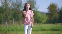 Beautiful little girl sends an air kiss Stock Footage