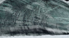 Wipers cleaning an icy windshield Stock Footage