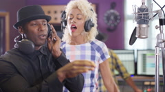 4K Young black music artists singing into microphone in recording studio Stock Footage