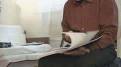 Cultured old man reading a old book Stock Footage