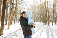 Happy father playing with little child son boy in winter nature Kuvituskuvat