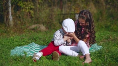 Little children play with a mobile phone in the garden Stock Footage