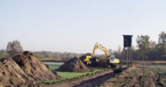 Earthwork with excavator for wetland restoration Stock Footage