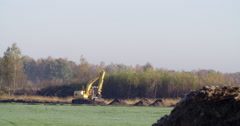Earthwork with excavator for nature restoration Stock Footage