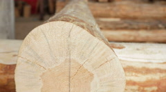 Background: wooden logs in the future house. Close-up and moving camera Stock Footage