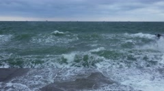 Stormy Sea Waves Breaking on a Concrete Pier Stock Footage