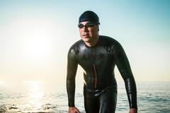 Man in diving suit on seashore Stock Photos
