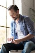 Happy delighted man writing with a pencil Stock Photos