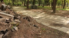 Pile of the construction debrits in a park zone Stock Footage