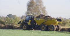 Earthwork with dump truck for nature restoration Stock Footage