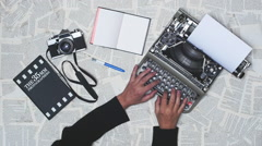 Person typing on a vintage typewriter with vintage 35mm camera. Stock Footage