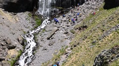 Athletes restore power on the mountain near the waterfall. Motivation. Success. Stock Footage